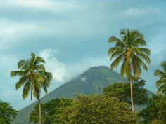 Rearing up out of the frothing waters of Lake Nicaragua and crowned by a wispy garland of clouds, the twin peaks of Volcan Maderas and its larger, still. Ometepe, Budget Travel, Travel Guide, Travel Plan, Travel List, Travel Goals, Bosnia Y Herzegovina, Visit Jamaica, Caribbean Sea
