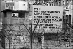 Magnum Photos — Leonard Freed — West Berlin. 1961. Looking from the west side toward the east side during the building of the Berlin Wall.