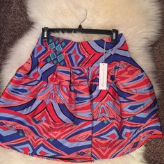 T-Bags Los Angeles Skirt Size Large T-Bags Los Angeles Size Large knit skirt w/graphic print and seaming throughout. A-line hem and tonal stitching and panel seaming. Back exposed zip closure. Material 96% polyester/ 4% spandex she'll. T-Bags Los Angeles Skirts A-Line or Full