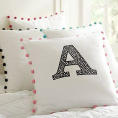 I love the Color Pop Mini Dot Appliqué Pillow Cover on pbteen.com