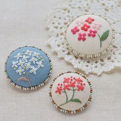 Embroidered button brooches
