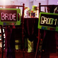 Lite-Brite bride and groom chair signs // Jessica Monnich Photography // http://www.theknot.com/weddings/album/an-80s-themed-wedding-in-austin-tx-85269