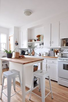 This IKEA island provides the perfect amount of space for one person to sit, but you can squeeze in three or four if you're ambitious! Kitchen Island Breakfast Bar Ideas & Inspiration | Apartment Therapy
