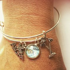 Get Mauied with our latest map & charms bangle!