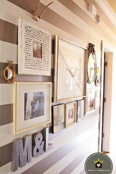 Great hallway photo grouping. Love this idea. Wedding picture, engagement, sealing pictures, Frame the invitations. Love it.