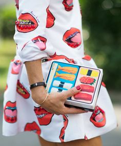 Details in street style. Anna Dello Russo wearing Au Jour le Jour lip print dress and sushi clutch at Milan Fashion week Spring 2015 #aujourlejour #pfw Photo:Younjun Koo