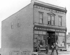 """TITLE        Hudson's Bay Co., General Store, 1894. -- SOURCE       Main Branch. SOURCE       Photograph (8"""" x 10""""). DATE         1894. DATE         1894. SUBJECT      Sudbury -- Buildings -- Stores and Services. NOTE         City of Greater Sudbury Heritage Museums Collection. NOTE         Donated by Sam Rothschild. NOTE         SPL 159. NOTE         SPL 235. NOTE         SPL 236. NOTE         North side of Larch St. at Durham.  Manager J.H. McEachern. NUMBER       MK0313EN."""
