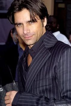 John Stamos turns 50. Looks better than ever. (my friend does his TV makeup, so give her props!)