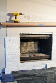 How to install stacked stone tile on a fireplace wall | Thrifty ...