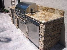 Image of Astonishing Outdoor Kitchen Refrigerator Stainless Steel and Colonial Gold Granite Kitchen Countertops also Stainless Steel Sheet for Outdoor Kitchen Cabinet Doors with Polished Chrome Door Handles