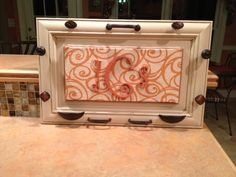 Jewerly Holder made out of a cabinet door & hardware - Back the fabric with corkboard and use as a cork board -