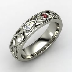 Husband/Wife birthstone ring in the infinity symbol, want!