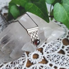 Tiny pendant with sterling silver and garnet. --- #amadestudio #handmadejewelry #bohostyle #artisanjewelry #handcrafted #silverjewelry #silverart #pendant #bohochic