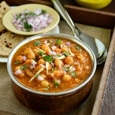 Restaurant Style Channa Masala - Chickpeas cooked in spicy and tangy onion tomato gravy.