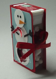 Darlene's Stampin Up Idea: Use large Holiday Tic Tac Container for special treat. Cardstock only glued on back of container. Don't forget to punch hole in bottom of snowman.