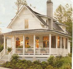 Dear Lord, please let our next house have a wrap around porch like this one :-)