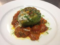 Japanese Green Pepper stuffed with Italian sausage and gruyere cheese and served with a roasted tomato sauce.