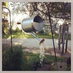Earth Day Activities: Let a plain watering can sprinkle some sparkle on your garden #ecofriendlycrafts #ecofriendly #earthdaycrafts #greencrafts