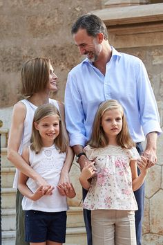 Spanish King Felipe VI (top R) and Queen Letizia (top L) pose with their daughters Spanish Crown Princess Leonor (bottom R) and Infanta Sofia at the Marivent Palace on the island of Mallorca on August 3, 2015. The royal family traditionally spends its summer holidays at the Marivent Palace.