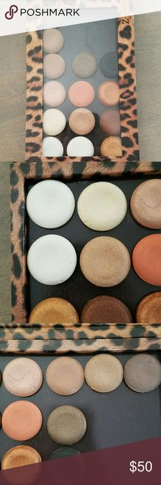 Milani Bella eyeshadows in large  Z palette This labor of depoting love includes 14 Milani Bella eyes gel shadows labeled on bottom. Colors include espresso, black, copper, brown, gold, Mandarin, sand, white, taupe, caffe, cappuccino, champagne, chiffon, and shimmer. Formula starts as gel and drys as a powder can be used wet or dry. Some used once or not at,all.  Z palette in Leopard  fits 18 of the milani and 27 makeup geek size shadows. Large Size palette is 8 x 4.75. If you want shadow…