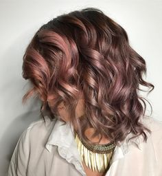 Check out this new chocolate-mauve hair color trend.