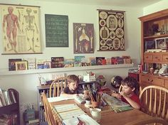 nifty homeschool room w/ book ledge, posters, bookcase, ...