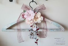 adding a Gabrielle butterfly and the grande bird cage to a shabby altered clothes hanger I created .