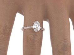 Oval cut diamond 1.1 carat, rose gold band with pave'