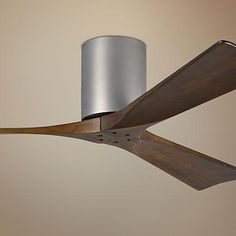 Walnut stained blades contrast beautifully against a brushed nickel finish motor in this 3-blade hugger ceiling fan design.