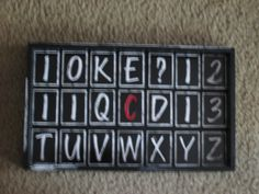 A tray upcycled with letters.