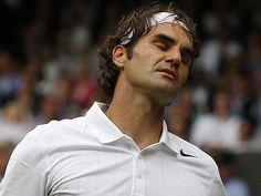 Roger Federer (Switzerland) loses to Novak Djokovic (Serbia) - 2014 Wimbledon Gentlemen's Singles Final. Djokovic def. Federer 6-7(7-9), 6-4, 7-6(7-4), 5-7, 6-4