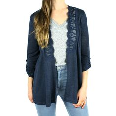 This knit cardigan in navy has a gorgeous lace trim around the neckline in  front and lining the cutout panel in back. Sleeves roll up and stay with  tab & button and the back features tiny pleating under the lace panel for  an extra swingy look. Wear over a printed top or tank for a subtle sexy  look. Model is wearing size small.    Rayon/Polyester  Hand Wash Cold