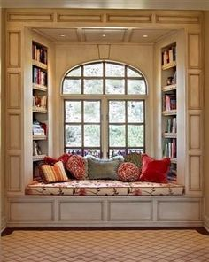 This is absolutely something I've always wanted the ultimate in window seating.  What a cozy way to enjoy a good read.
