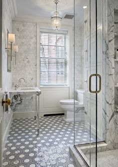 Froghill Designs Blog White carrara marble walls, mosaic tile floor, white pedestal sink, beautiful lighting, chandelier and sconces, glass shower, #gorgeous bathroom #whitebathroom #carraramarble