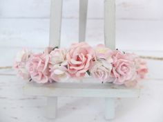 This flower crown features light pink flowers mixing with white pink mini peonies and cherry blossoms.  PLEASE NOTE The colors may appear lighter in