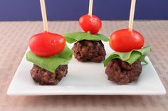 Hamburger appetizers... using mini meatballs, lettuce, grape tomatoes, with mayo & ketchup dip on the side.