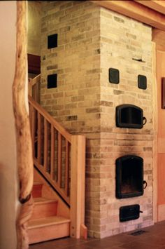 Masonry woodstoves offer many distinct advantages over metal woodstoves and conventional fireplaces. Stove Fireplace, Fireplace Design, Stair Shelves, Passive Solar Homes, Thermal Mass, Wood Stoves, Solar House, Rocket Stoves, French Kitchen