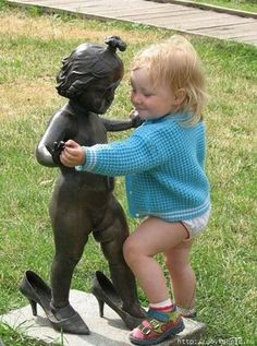Girl dancing with statue