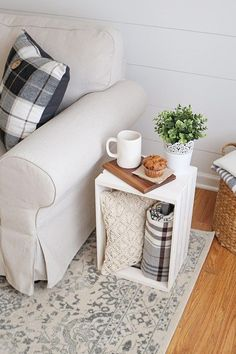 How to use a wood crate as a side table! Works great as practical and cute living room decor too! An easy and cheap side table!