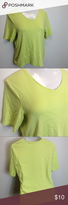 Chico's Lime Green V-Neck Tee Soft basic tee perfect for sunny days with denim shorts or worn under a blazer for work.  Chico's has unusual sizing.  Tag says size 2 which is closer to a 12/14 which is why it's listed as a large.  100% cotton.  Excellent condition. Chico's Tops Tees - Short Sleeve