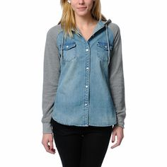 Skip the lumberjack look and go straight to street style with the Empyre Girl Sycamore shirt hoodie in a light faded denim colorway. This Empyre Girl hooded shirt features a blue denim body, a contrasting heather grey hood and sleeves, two front chest pockets and long raglans sleeves. Perfect by itself layered with your favorite bomber jacket, the The Empire Girl Sycamore hooded denim shirt has plenty of style for you.