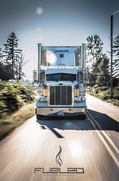 White Peterbilt reefer rolling down the road