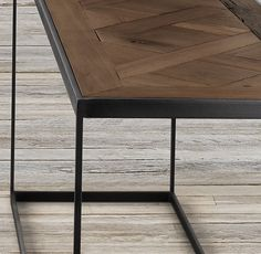 Beautiful wood and frame -  RH's Reclaimed Russian Oak Parquet Console Table:Merging Old World and industrial influences, our distinctive collection features a geometric parquet top – handcrafted of solid reclaimed oak timbers from decades-old buildings of Russia – supported by a sleek, angular metal frame.