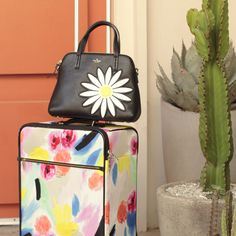 """shop the looks from #missadventure season 2, episode 1, """"the perfect weekend"""" featuring the classic nylon international carry-on and down the rabbit hole daisy applique leather maise."""