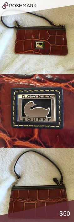 DOONEY and BOURKE WRISTLET Dooney and Bourke wristlet. Burnt orange brown in color. Alligator type print. Gorgeous wristlet. Perfect condition, no stains, no marks. Dooney & Bourke Bags Clutches & Wristlets