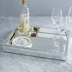 Mirror Tray from West Elm. Keep your make-up accessories and a vase of flowers on top of your vanity table.