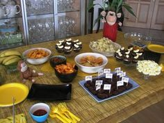 Really simple monkey party food included banana milkshakes, frozen bananas on sticks - dipped in chocolate, banana cupcakes with choc icing and lolly bananas on top, chocolate brownies with little monkey flags I made on the computer, banana jelly, crisps, pretzels, fruit skewers and chicken strips.
