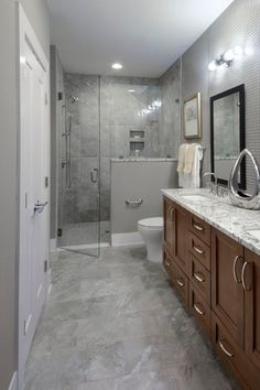 Contemporary 3/4 Bathroom with Winstead Cabinet Door Style By Aristokraft, limestone tile floors, Double sink, Flush