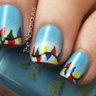 Cheerful and Colorful Christmas Themed Nail Art Design from The Nailasaurus - Sparklya nd Easy Red and White Christmas Nail Art with Snowfla...