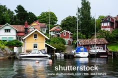 Typical Swedish houses with a small harbor in Vaxholm / Sweden.